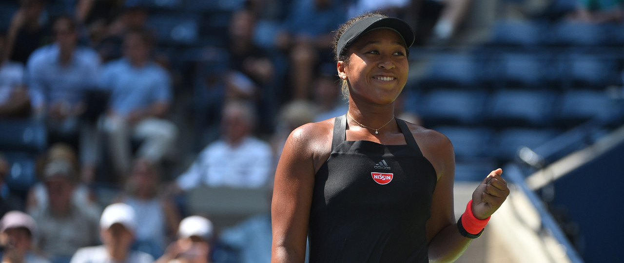 Naomi Osaka smiling at the 2018 US Open carrousel