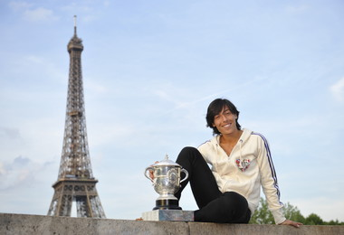 2010 Roland-Garros women's singles champion Francesca Schiavone poses with the Coupe Suzanne-Lenglen in front of the Tour Eiffel