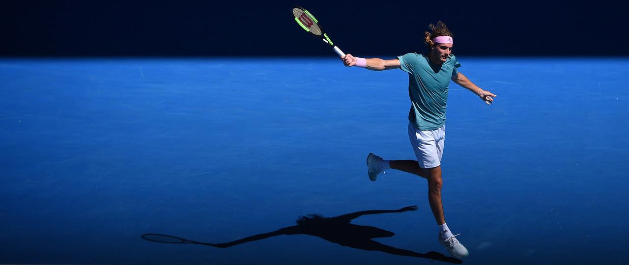 Stefanos Tsitsipas hitting a backhand at the 2019 Australian Open