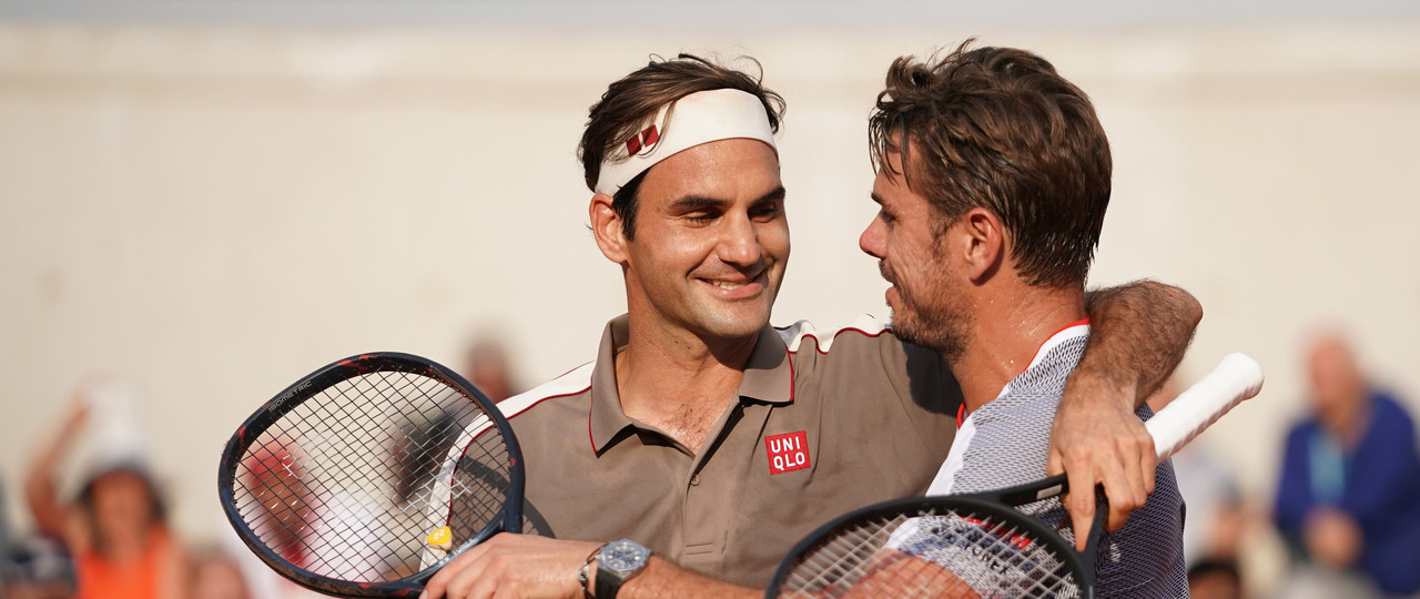 Roger Federer and Stan Wawrinka hugging at the net Roland-Garros 2019