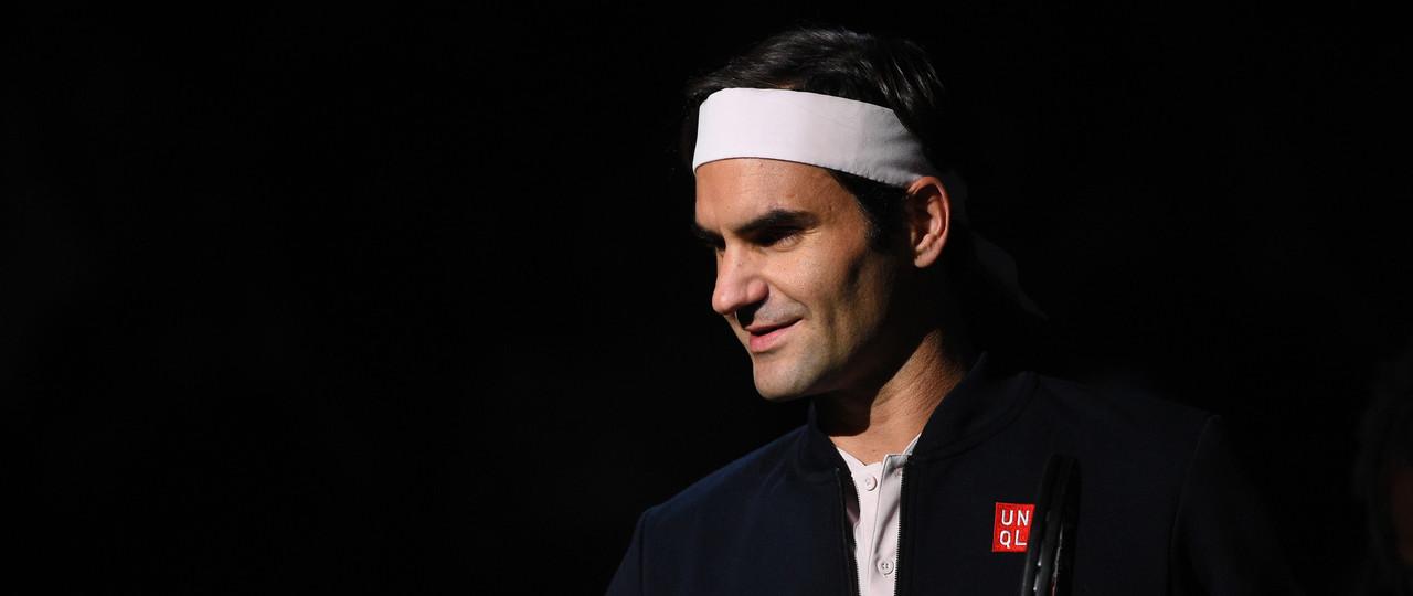 Roger Federer smiling at the 2018 Rolex Paris Masters slider