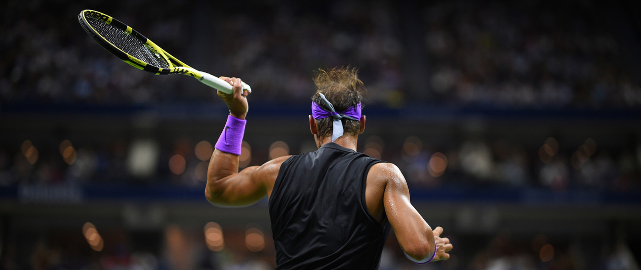 Rafael Nadal's back while hitting a forehand during the 2019 US Open finale