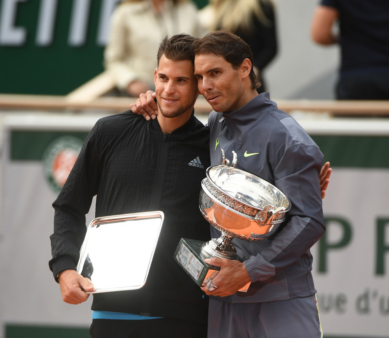 Dominic Thiem and Rafael Nadal on the podium smiling Roland-Garros 2019