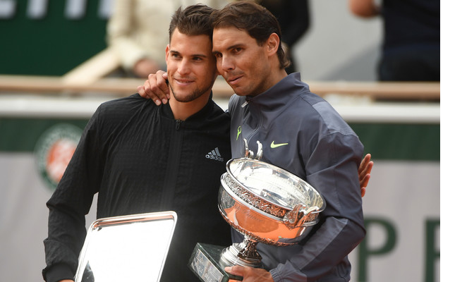 Dominic Thiem and Rafael Nadal on the podium smiling Roland-Garros 2019