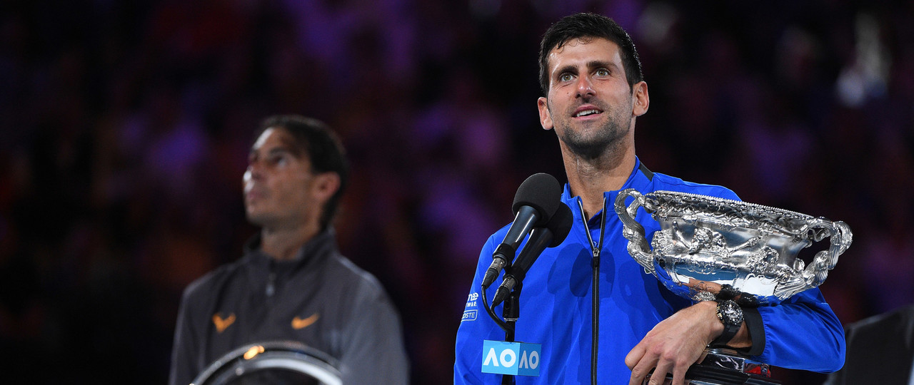 Novak Djokovic and Rafael Nadal on the podium for the 2019 Australian Open trophy presentation