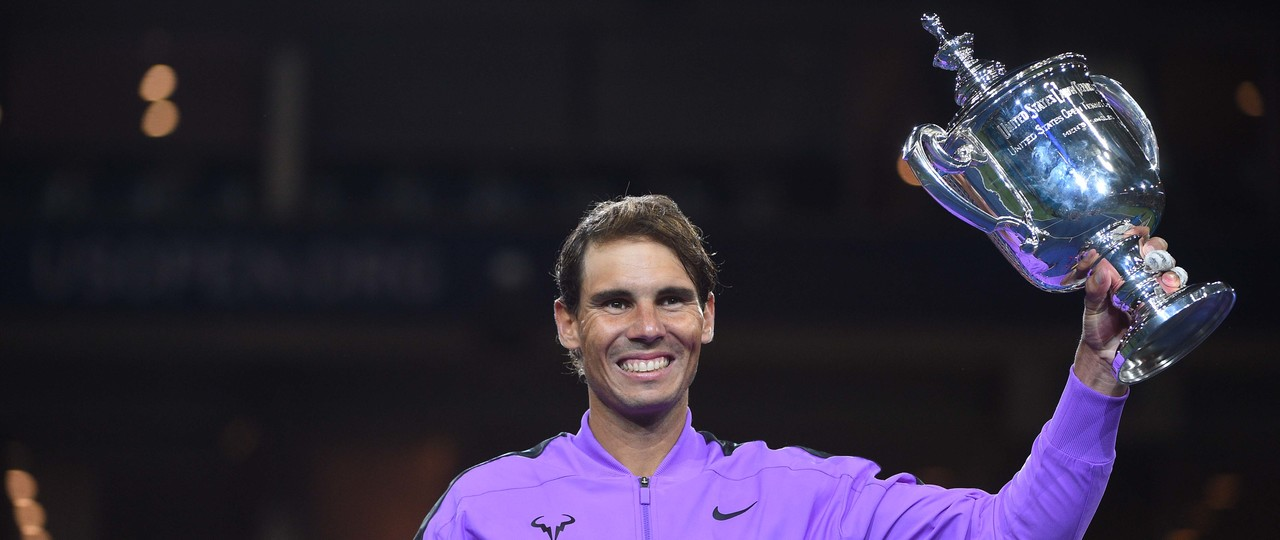 Rafael Nadal lifting the 2019 US Open trophy