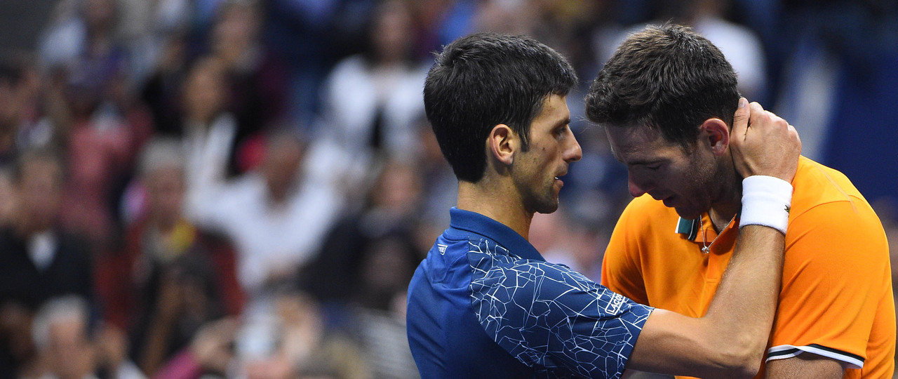 Novak Djokovic talking to Juan Martin del Potro at the net after the 2018 US Open final